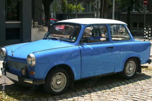 Blue vintage restored Trabant car on paved street Canvas Print