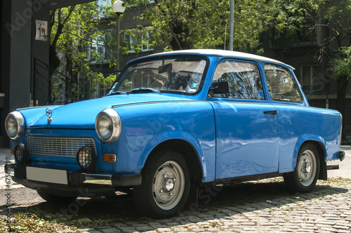 Blue vintage restored Trabant car on paved street Fototapete