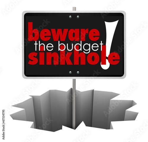 Fototapeta Beware the Budget Sinkhole Sign Hole Money Trouble Bankruptcy