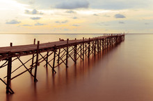 Wooden Beach Pier With Color F...
