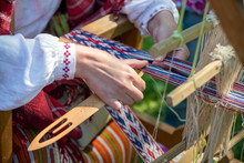 Woman Working At The Weaving L...