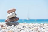 Fototapeta Kamienie - Relaxing on the beach