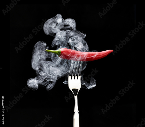 Staande foto Hot chili peppers red hot chili pepper on fork