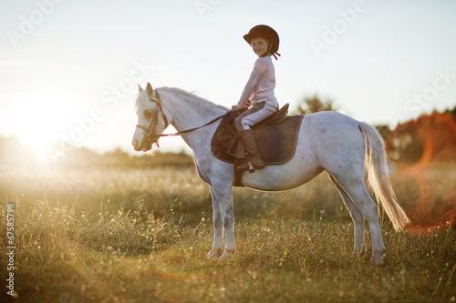 Fotografie, Obraz  Girl riding a horse