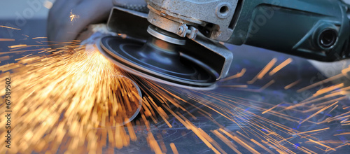 Fotografie, Tablou Worker cutting metal with grinder