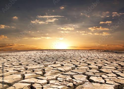 Drought land against sunset