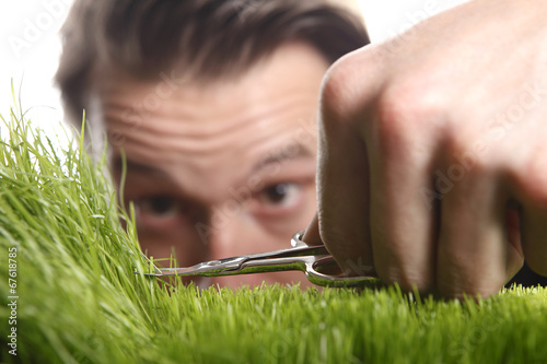 Young man cuts English lawn Tablou Canvas