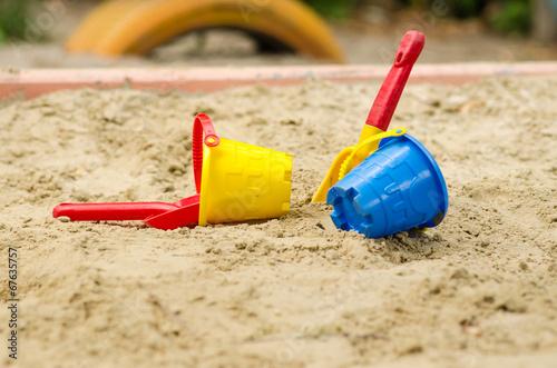 Fotografie, Obraz  Toy bucket and shovel in the sandbox