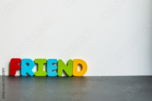 Fotografia, Obraz  Colorful wooden word Friend with white background