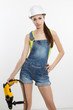 sexy builder woman with a drill in her hands