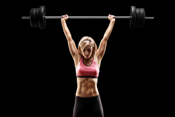 Muscular woman lifting a he...