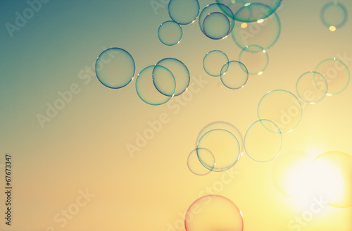 Soap bubbles floating in the air as the Summer sunsets