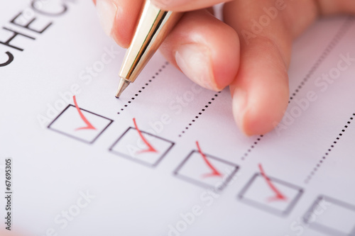 Fotografie, Obraz  Businesswoman Writing On Checklist