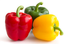 Red, Yellow, Green Peppers On White Background.