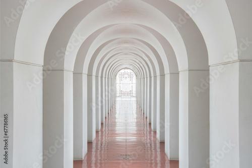 Long empty corridor and doors in to success