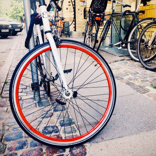 Photo  Bicycle wheel with red rim.