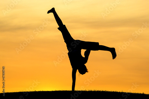 Cartwheel with one hand.