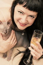 Photo Of Beautiful Woman With Glass Of Champagne And A Cat