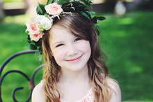 Portrait Of Adorable Kid Girl With Floral Wreath