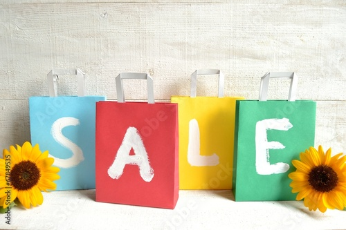 Colorful bargain sale shopping bags with sun flower Wallpaper Mural