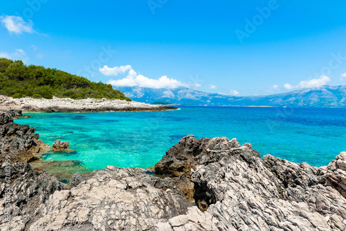Valokuva  Rocky shore with turquoise sea water. Adriatic coast of Korcula