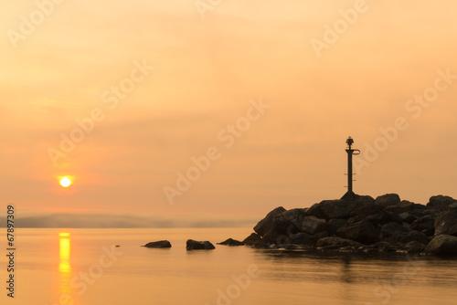 Garden Poster Lighthouse Ocean shore in fog