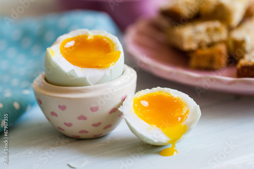 Photo  Opened boiled blue duck egg with soft yolk