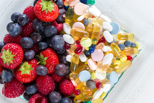 Fotografie, Obraz  Healthy lifestyle, Fruit and pills, vitamin supplements