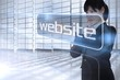 Businesswoman looking at the word website