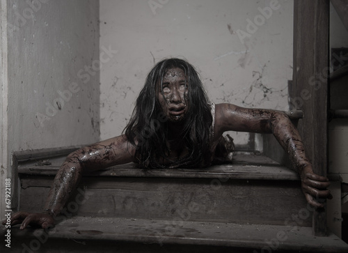 Zombie girl in haunted house scary Canvas Print