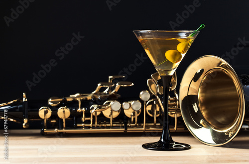 saxophone and martini with green olives - 67944778