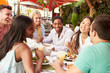 canvas print picture - Group Of Friends Enjoying Lunch In Outdoor Restaurant