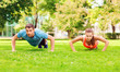 canvas print picture - couple doing push-ups outdoors