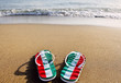 flip flops on beach sand - holidays and relaxation concept