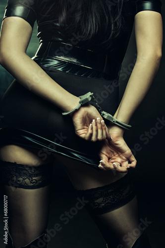 Photo  Woman in handcuffs