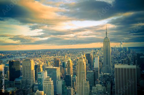 Fotografie, Tablou  New York City skyline under dramatic evening sky