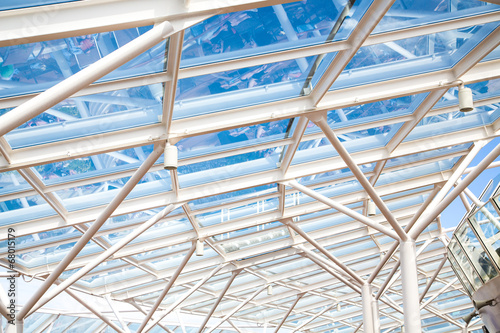 Photo Glass Atrium Roof Supported by White Steel