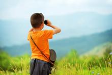 Little Boy Looking Through Bin...