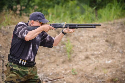 Obraz na plátne Shotgun Shooting Training. Outdoor Shooting Range