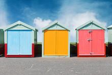 Colourful Beach Huts In Brighton On The Beach