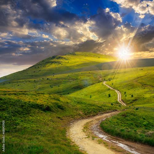 mountain path uphill to the sky at sunset Fototapeta