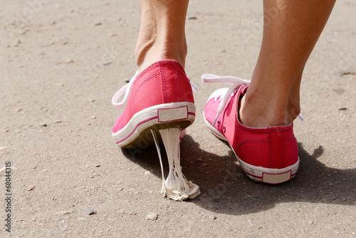 Fotografie, Obraz  Foot stuck into chewing gum on street
