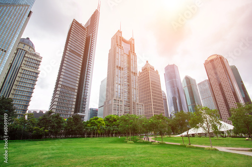 city park with modern building background in shanghai Poster