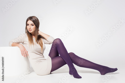 Beautiful Woman With Long Sexy Legs Wearing Stockings Posing - Buy This Stock Photo -4237