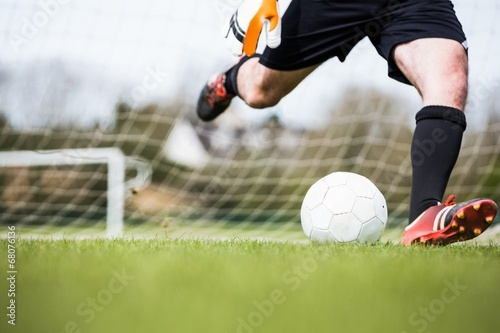 Goalkeeper kicking ball away from goal