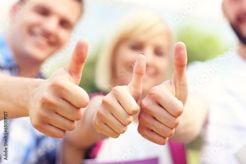 Valokuva  Students showing ok sign