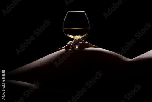 Fototapeta Beautiful, nude woman body silhouette and a glass of drink obraz