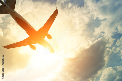 Toned photo of commercial airplane in the sun Fotobehang