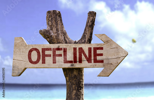 Photo  Offline wooden sign with a beach on background