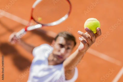 Young man playing tennis